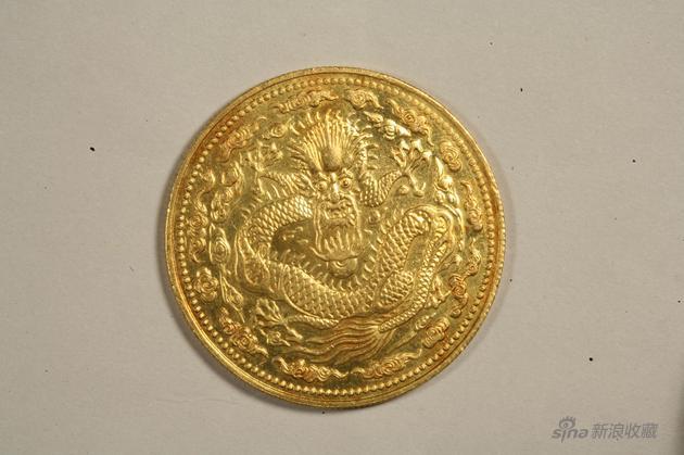 235b丁未大清金币一两,重量36、2克,直径38、9毫米。