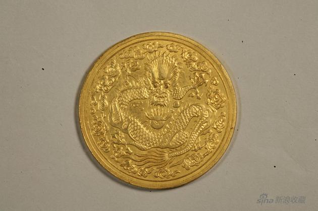 234b丙午大清金币一两,重量37、2克,直径38、8毫。光边。