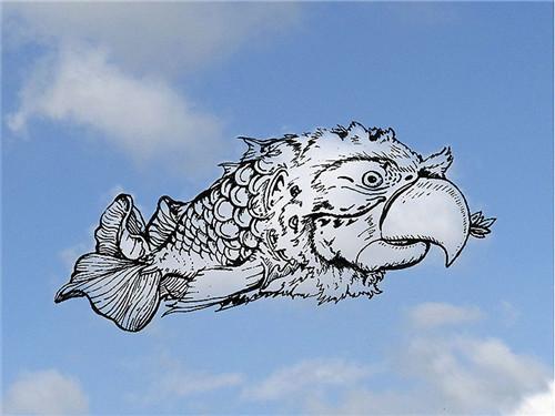 最后,根据云朵的形状,他用黑色的画笔在透明的画纸上画下图案.