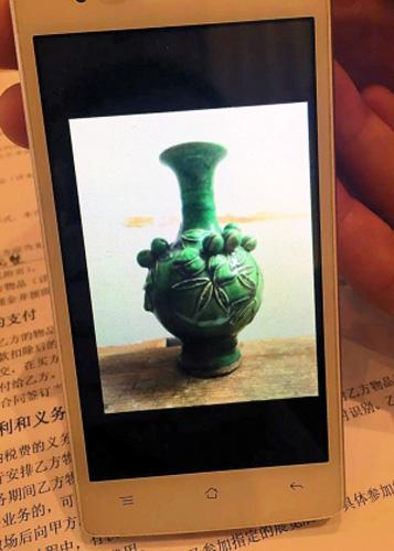 付先生只有一张陶瓶未损坏前的照片,此外已无其他证据