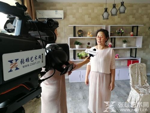 张雄艺术网黑龙江站与纳帕庄园结盟并采访了海林纳帕休闲庄园有限公司董事长周霞