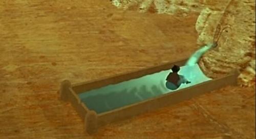 泉水出口的木雕图腾